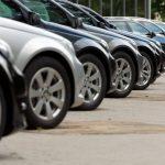 Albany man drives car into car dealership
