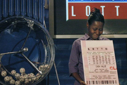 Jacklyn Lyte of Latham smiles as she looks down at her winning numbers Friday at state Lottery headquarters in Schenectady. Lyte won an $18 million Lotto jackpot.