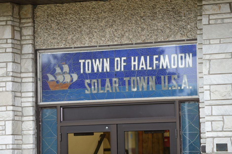 """A sign naming Halfmoon as """"Solar Town U.S.A."""" is seen outside Town Hall on Wednesday, October 22, 2014."""