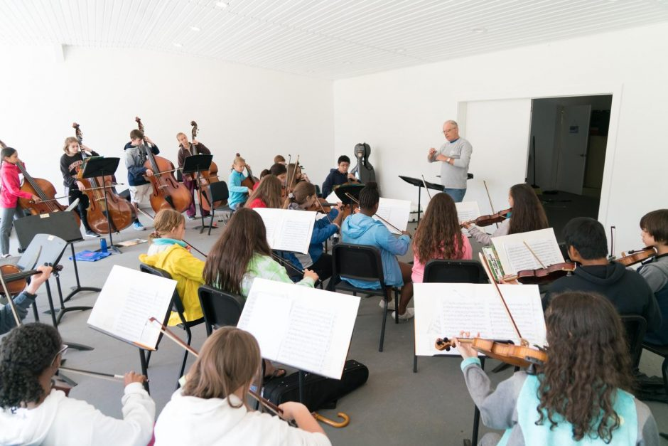 Students and teacher in a classroom at the summer camp at Luzerne Music Center in Lake Luzerne.