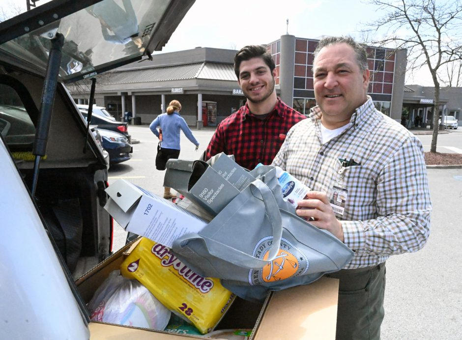 Dominick DiCarlo, right, and Nick Gallo have been delivering needed items to residents and checking in on homebound people.