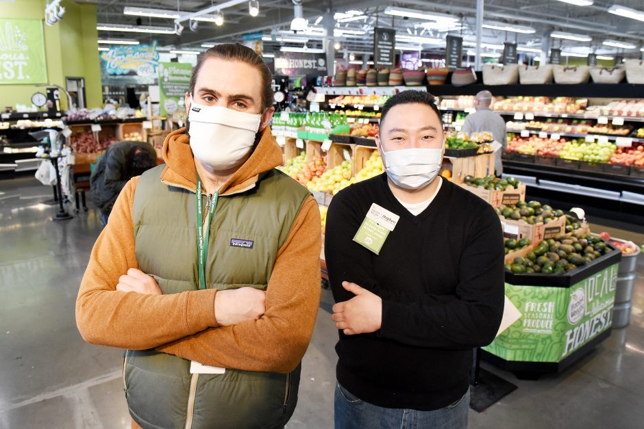 Alex Mytelka, left,and Stephen Quickentoninside Honest Weight Food Co-op in Albany on April 17.