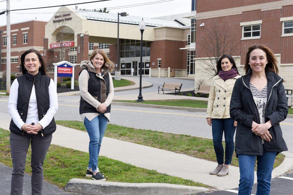 Andrea Macy, Becky Ryan Kern, Nadine Burke and Lisa Munter outside Saratoga Hospital on April 14.