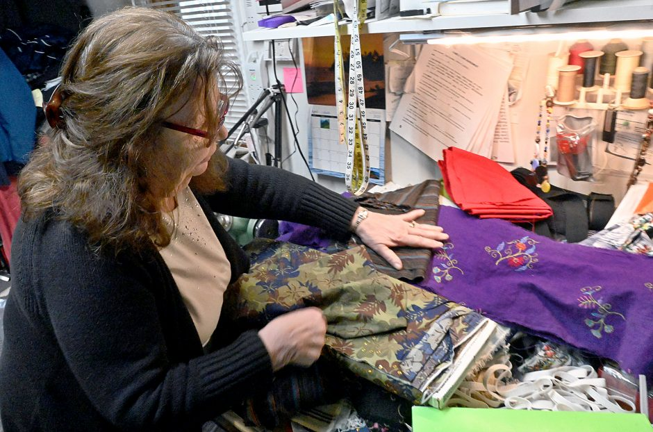 Denise Eagan, owner of Eagan's Alterations in Schenectady, picks out fabric for the next batch of face masks.