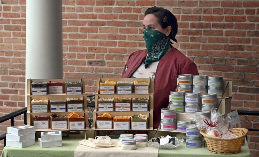 Leah LaFera of Sweet Sprig sells at the Schenectady Trading Company outdoor farmers market, held along lower Union St. on Sunday