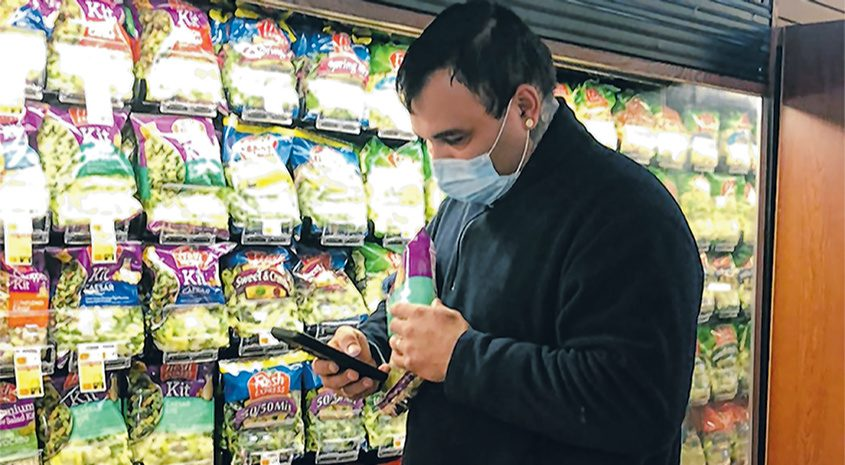 Instacart shopper Cory Santiago browses a store's selection. He shops mostly in Palatine Bridge, Johnstown and Gloversville.