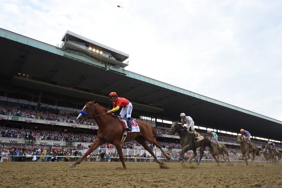 Justify wins the 2018 Belmont Stakes to clinch the 13th Triple Crown.
