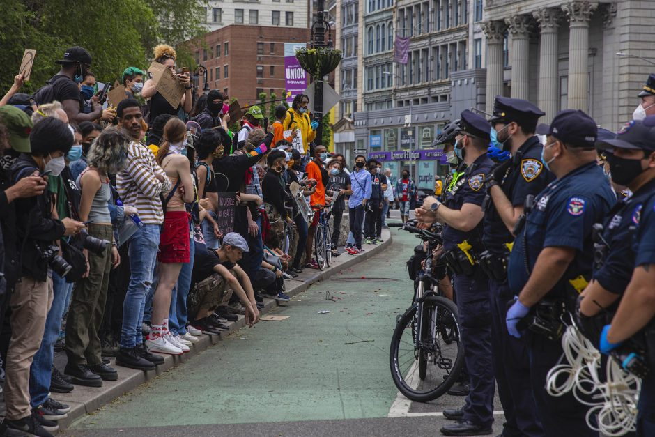 Protesters and police face each other in New York, May 28, 2020.