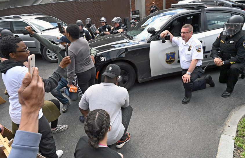 Schenectady Police Chief Eric Clifford kneels down Sunday in solidarity with protesters angered by the death of George Floyd.