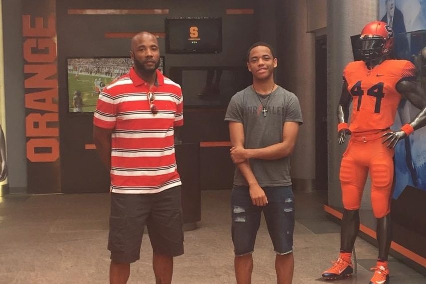 David Byrd Jr., left, and his son David Byrd III visit Manley Field House at Syracuse University.