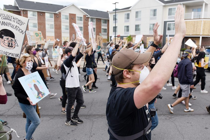 Protesters march from Troy Police Department back to Troy's Riverfront Park