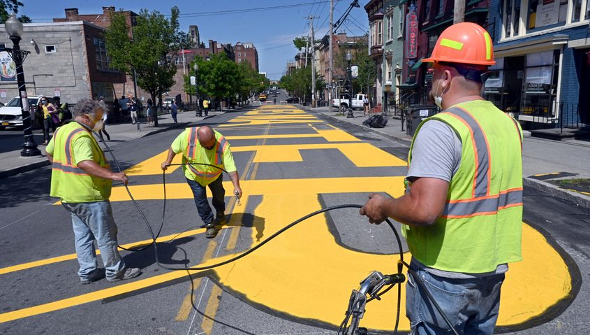 """A contract painting company stencil paints the middle of Lark St. with """"Black Lives Matter"""" Tuesday"""