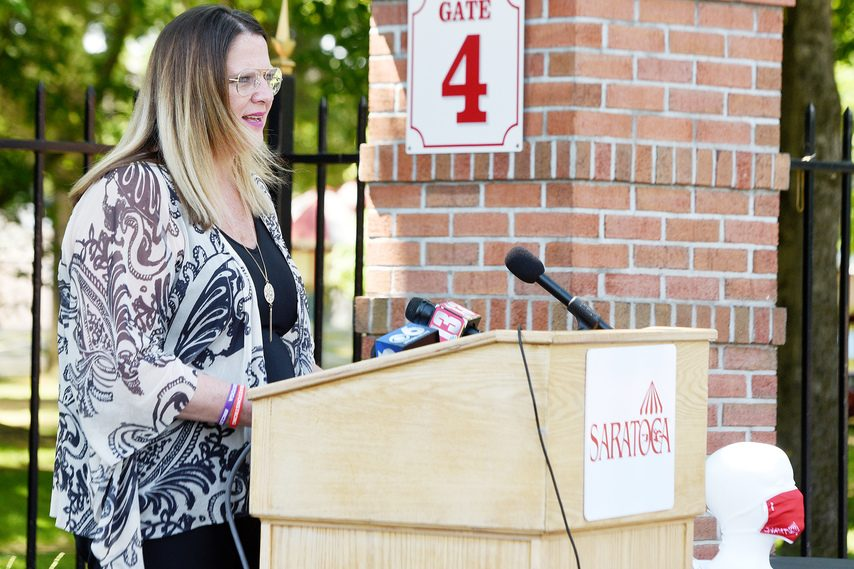 Karen Gregory, executive director of Shelters of Saratoga, addresses the media on Monday.