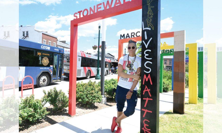 Artist Rae' Frasier altering the Pride Arches at Gateway park in Schenectady.