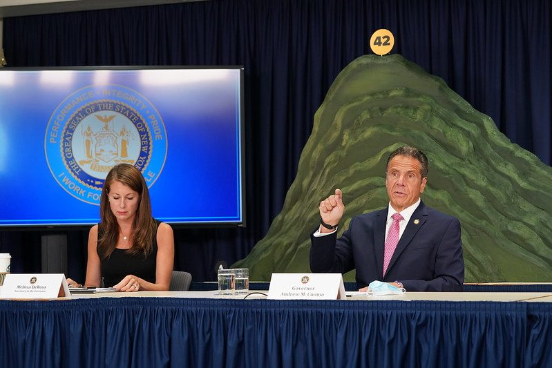 Gov. Andrew Cuomo speaks to reporters Monday in front of a mountain shaped like the COVID-19 curve in New York.
