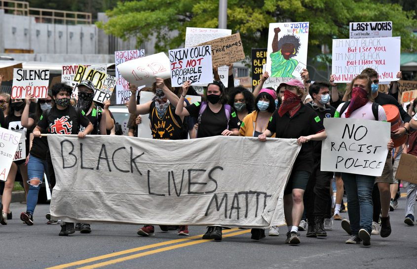Protesters walk down High Rock Avenue in Saratoga Springs as part of a Black Lives Matter rally June 7