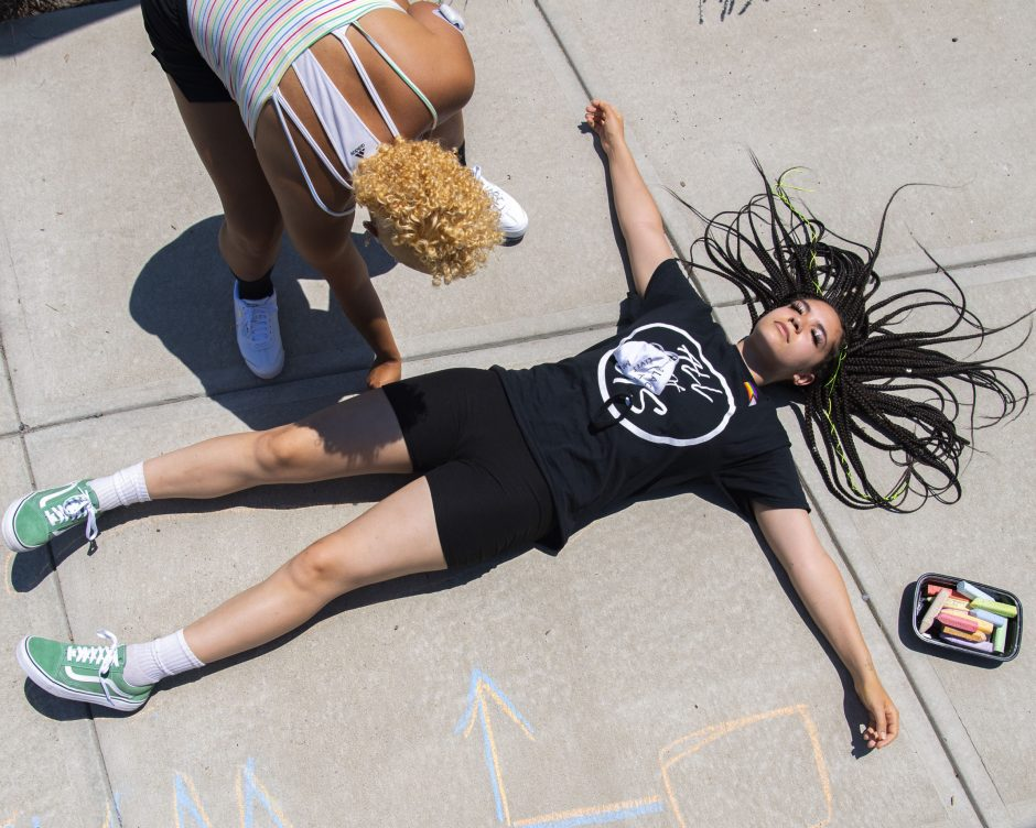 Mikayla Foster is traced in chalk by Tatyanna Hall in Gateway Park Saturday, July 4, 2020.