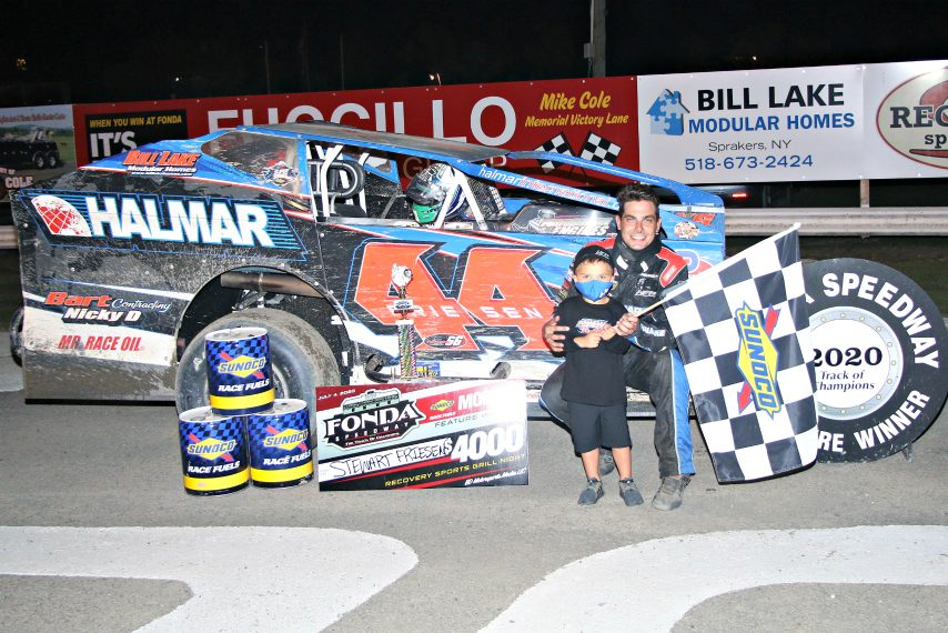 Stewart Friesen celebrates with his son, Parker, after winning Saturday's modified feature at Fonda Speedway.