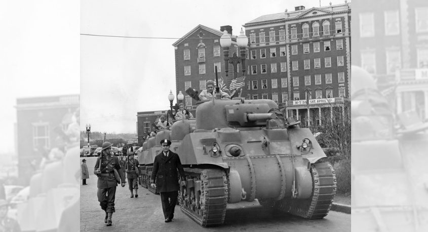 ALCO-made M3 tanks roll past the old Van Curler Hotel