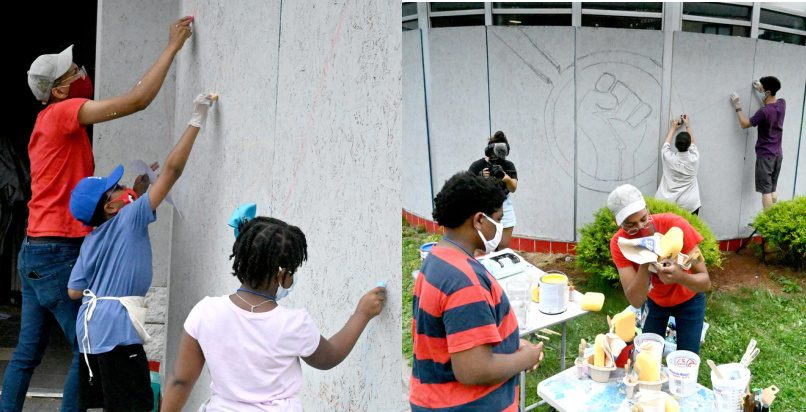 'Amplified Voices,' a group spearheaded by local artist Jade Warrick are working on a mural project at 106 S Pearl St. Thursday