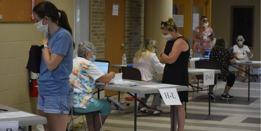 Voters sign in during the Greater Johnstown School District budget vote on Tuesday at Johnstown High School