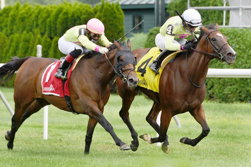 Classic Lady, right, outduels War Canoe to win the Dayatthespa at Saratoga.