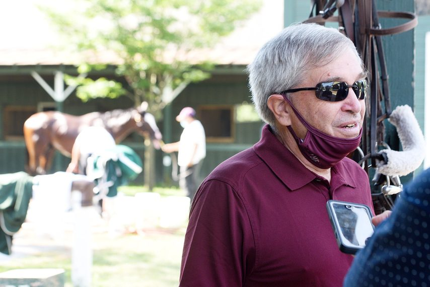 Sackatoga Stable's Jack Knowlton talks to the media while Tiz the Law gets a bath in the background on July 25.