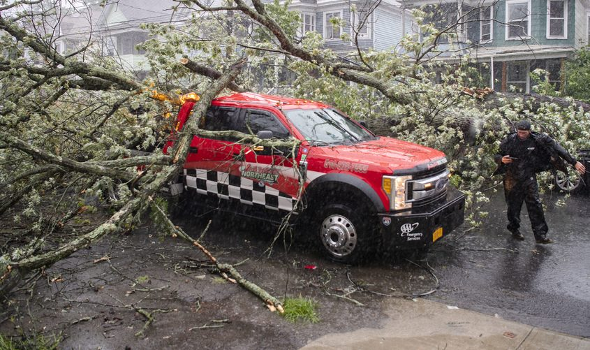 A falling tree hit this tow truck on Summit Avenue in Schenectady during Tuesday's storm.