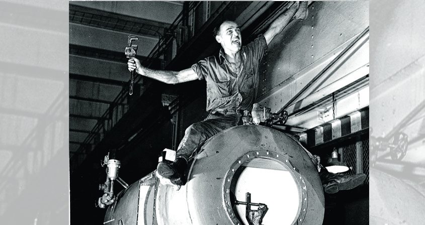 A.W. Kernaghan celebrates the end of World War II by riding a turbine component at the GE plant on Aug. 14, 1945 — V-J Day.