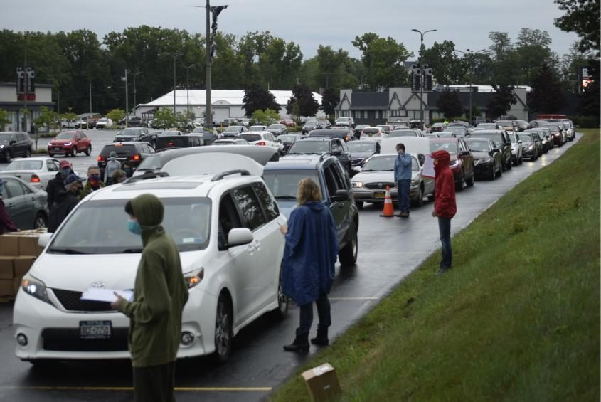 Cars line up in Crosstown Plaza for a drive-thru food pantry hosted by the Schenectady Foundation on Thursday.
