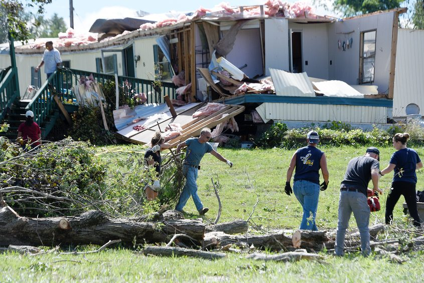 Friends and family work on clearing debris at the home of Myles and Kristen Mohan after a possible tornado hit ground Saturday evening on McDermott Road, off County Route 75, in #Stillwater #518wx @NWSAlbany pic.twitter.com/ql45O28oQX   — Erica Miller (@EricaPhotog) August 30, 2020