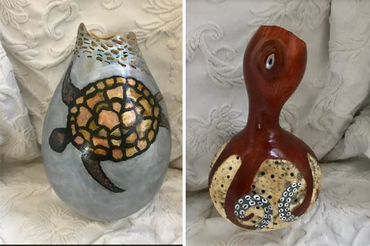 Two of Mary Jane Heffernan's carved and painted gourds are seen on display. Photos provided