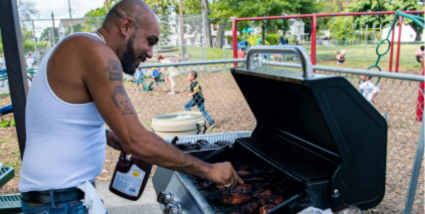 Tony Myers of Schenectady prepares barbecued chicken at a cook out at Jerry Burrell Park in Hamilton Hill, September 5, 2020. Photo by Peter Barber/Staff Photographer