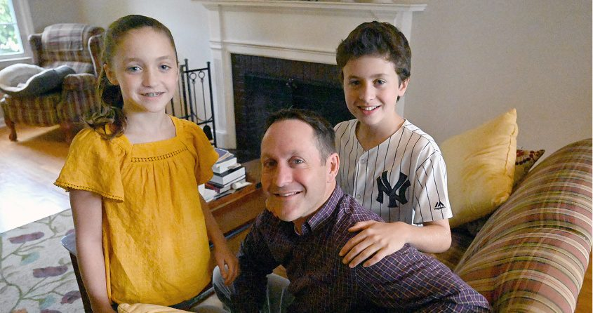 Iain Walker with his children Olivia and Jack at their home in Niskayuna. Photo by Marc Schultz/Staff Photographer
