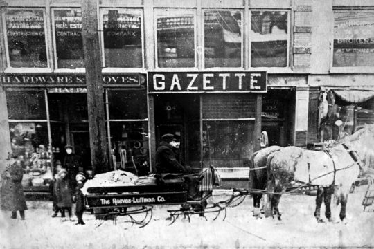 This photo shows a horse-drawn sled in front of the Gazette's offices on State Street around 1900.