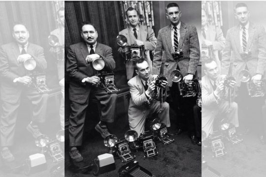 The Schenectady Gazette's photo staff, from left, are Charles B. Sellers Jr., Larry Hart and Ed Schultz. Kneeling is Sid Brown.