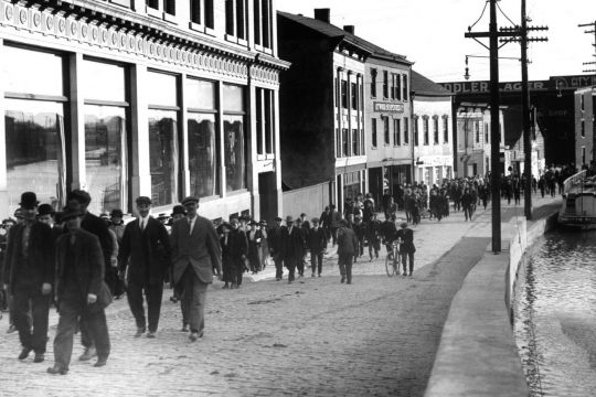 """People can still """"walk the curve"""" from the General Electric Co., but the Erie Canal is long gone. So are the people, seen walking toward State Street around the early 1920s. Cap Scrap loves this routine shot from the past ... that can prompt major interest today."""