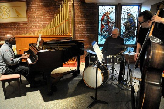 Nat Phipps, on piano, performs in a trio at Jazz Vespers at First Reformed Church in Schenectady. (Courtesy of First Reformed Church)