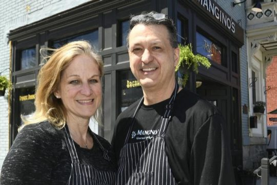 Bonnie Goodwin and Rick Mangino stand in front of Mangino's on Eastern Avenue in Schenectady in April 2019. Credit: Peter Barber/Gazette