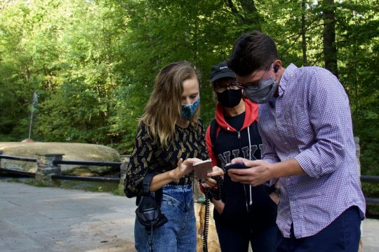 From left, composer Ellen Reid, SPAC President and CEO Elizabeth Sobol and Chris Shiley, senior director of artistic planning at SPAC, use the Soundwalk app at Saratoga Spa State Park. (Isabella Wager)