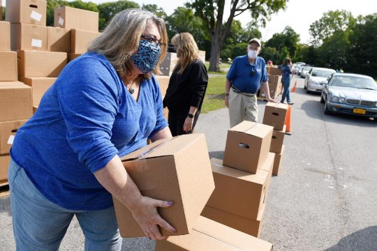 Volunteers distribute food boxes at Saratoga County Fairgrounds on September 16, 2020.