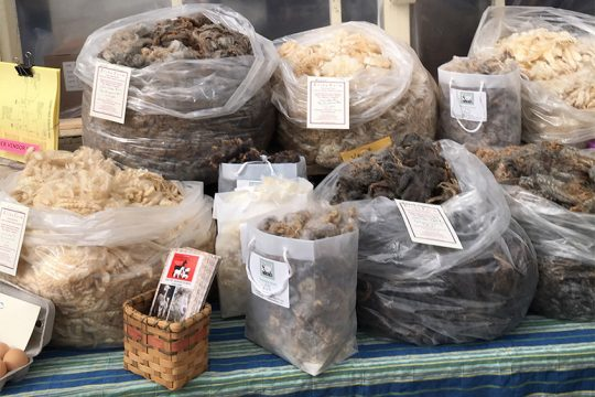 Bags of fleece for sale from Elihu Farms in Valley Falls at an earlier event. (photo provided)
