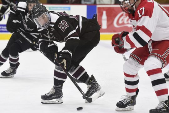 Union's Parker Foo (22) battles for the puck against RPI on Saturday, October 27, 2018